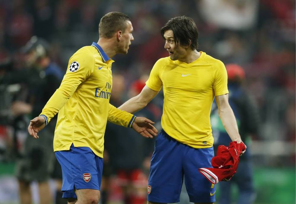 ad 129520144 e1394628436949 Podolski And Rosicky Row On Pitch After Champions League Exit