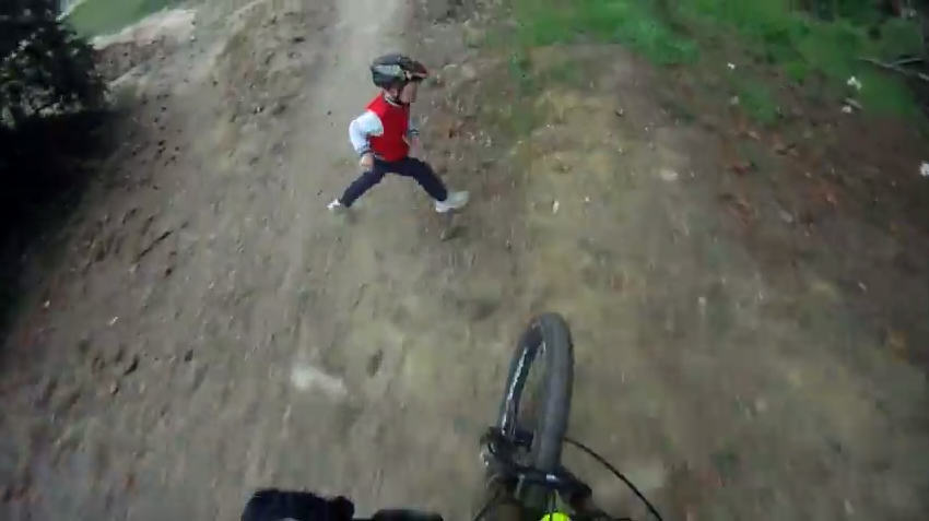 Kid Takes A Hit On An Active Mountain Bike Track 2