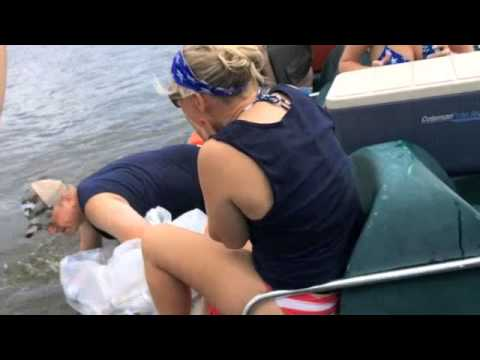 man proposes on a pedalo drops t