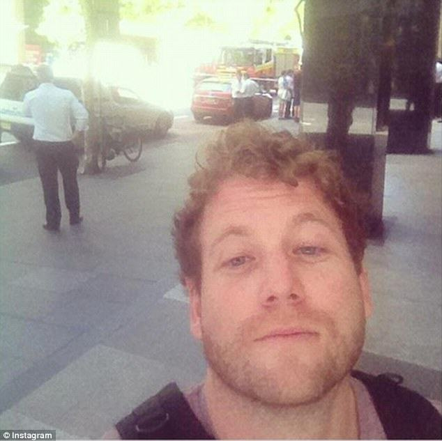 240F525800000578 2874191 These three men also looked pleased to be in Martin Place despit a 2 1418630836938 People Are Taking Selfies Outside The Terror Siege Thats Happening In Sydney