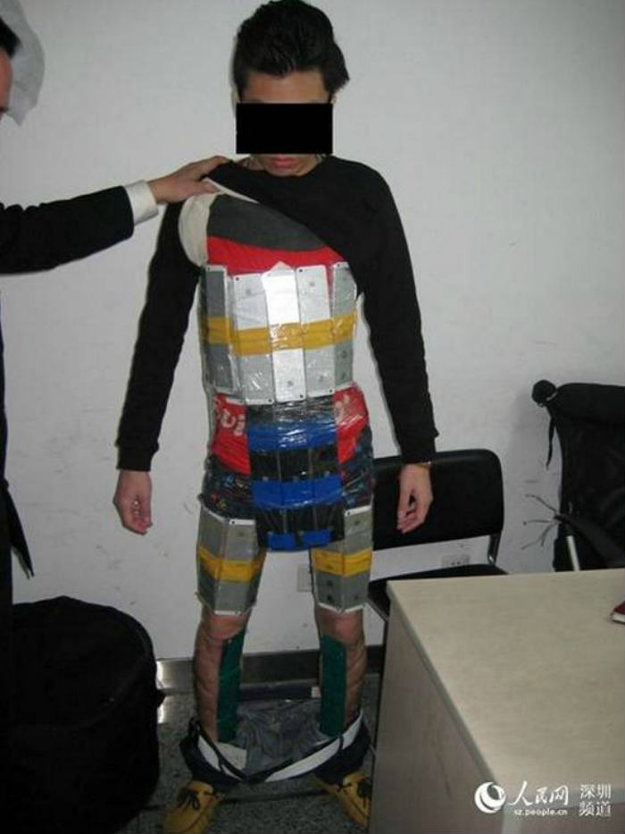 ad 156543320 This Man Got Caught Smuggling 94 iPhones By Strapping Them To His Body