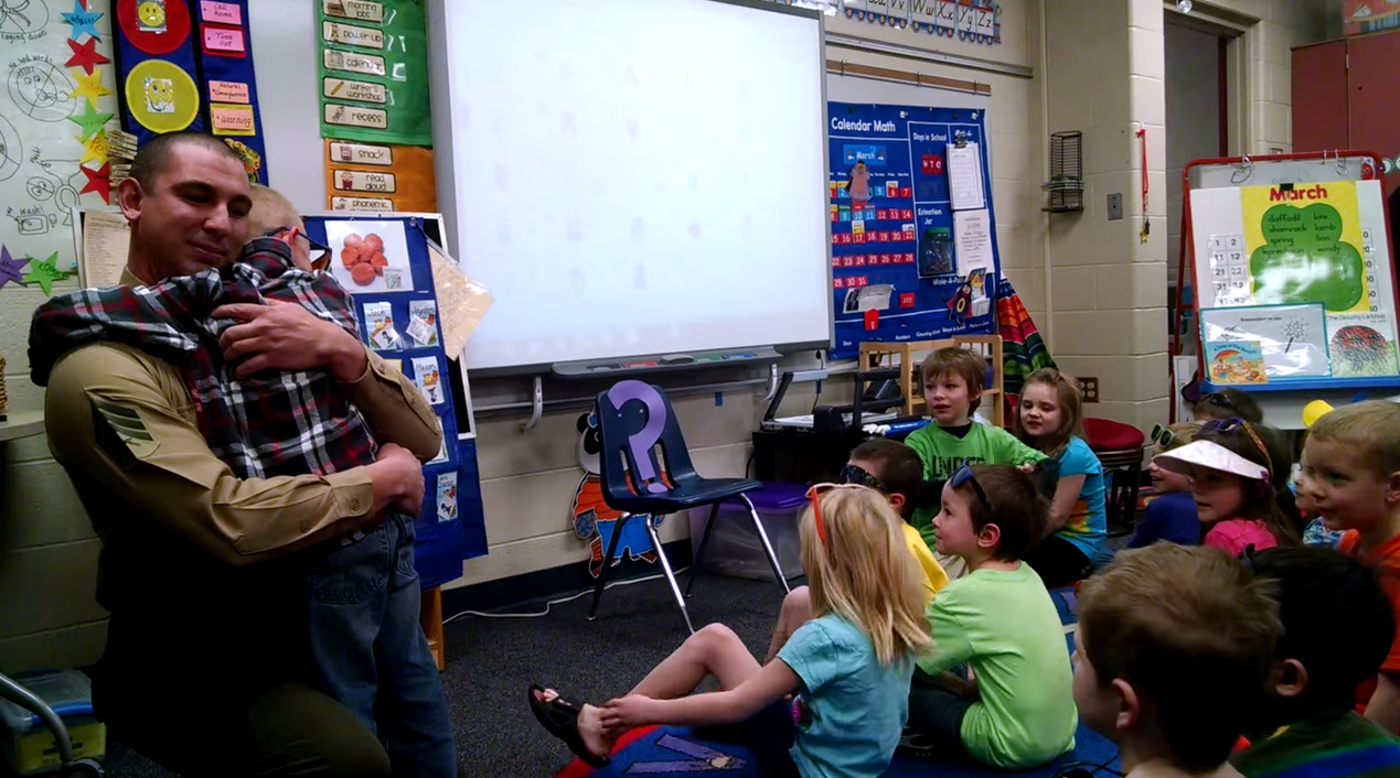 Screen Shot 2015 03 25 at 10.57.34 Marine Surprises His Son At School As Mystery Reader