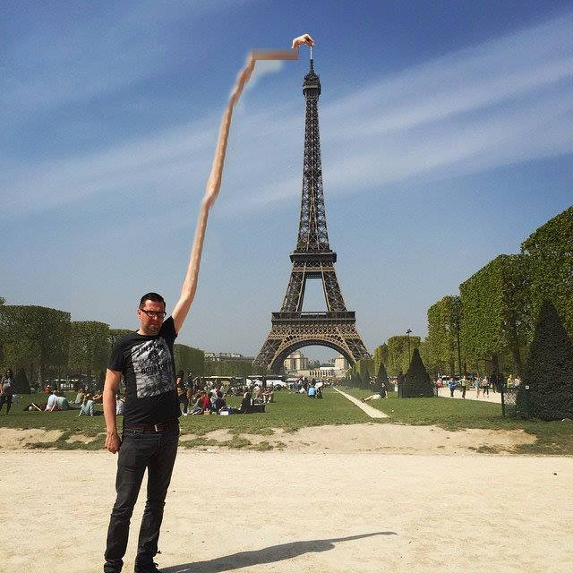 196 This Guy Posing Next To The Eiffel Tower Is The Latest Internet Craze