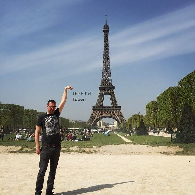 64 This Guy Posing Next To The Eiffel Tower Is The Latest Internet Craze