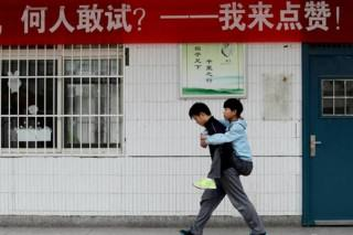School Kid Gives Disabled Friend Piggyback To School Everyday For Three Years