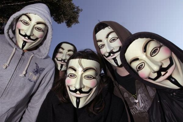 anonymous Protesters In Anonymous Masks Stage Sit In At McDonalds, Force Store To Close