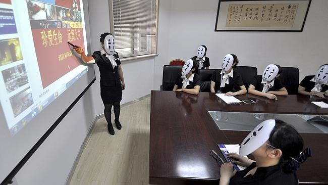 316 Chinese Workers Go Faceless For A Day To Avoid Faking Expressions