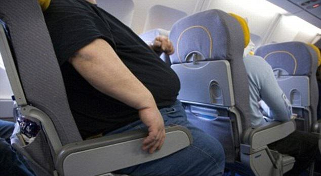 Iz6ORTYW52.jpg Airplane Passenger Sues For Back Injury   Caused By Sitting Next To Obese Man