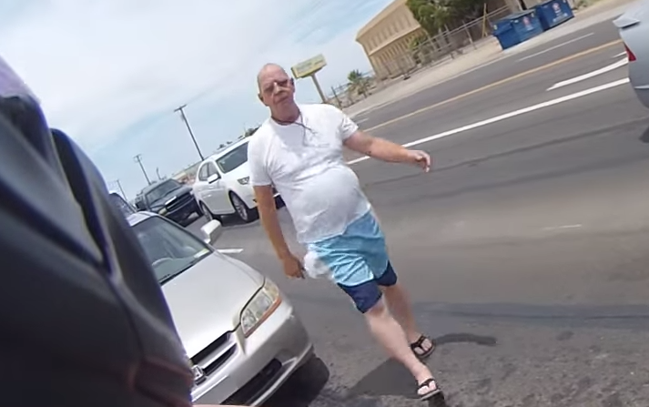 Screen Shot 2015 07 15 at 16.31.17 Man Punches Motorcyclist In Road Rage Attack, Regrets It Instantly