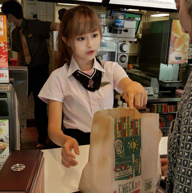 UNILAD PAY Woman Hsu Wei han working at the front counter of a McDonalds restaurant cen5 This 'McDonalds Goddess' Has Fans Who Flock To See Her