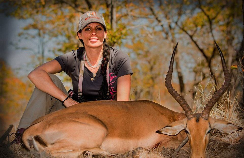 pdK2pyNaT2B07142800000578 3182671 Another one Above Corgatelli poses over an impala a breed of ant a 6 1438485747877.jpg Huntress Is Posting Pictures Of Her Kills Online, Doesn't Care What 'Haters' Think