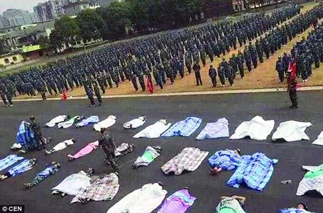 UNILAD 2C74912100000578 3239708 image a 1 14425683345552 Chinese Students Forced To Sleep Under Thick Blankets In Sweltering Heat For What?