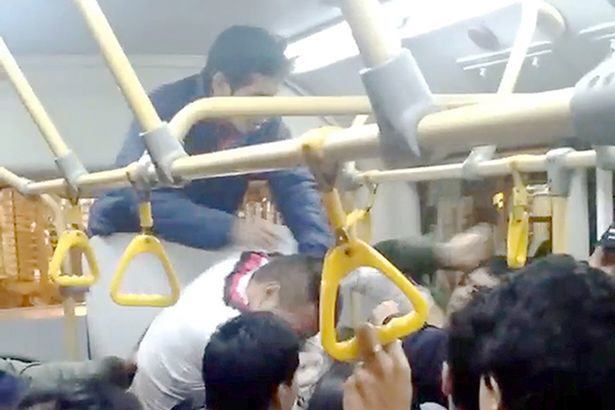 UNILAD busf13 Seriously Brutal Fist Fight Breaks Out On Crowded Bus