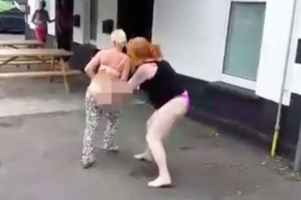 Two Women Strip Half Naked And Gyrate On Each Other At The Pub 3