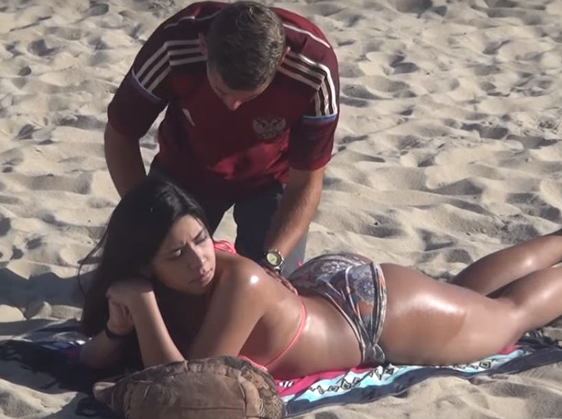 UNILAD 388856 Men Rub Sun Cream Onto Bikini Clad Girl On Beach, Get Big Surprise