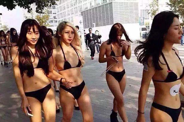 Nearly Naked Models Clash With Police For Asking Men To Scan Codes On Their Bums UNILAD Cen64003