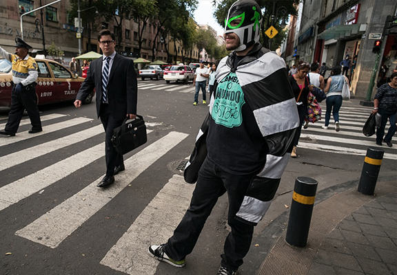 Masked Wrestler Grapples With Traffic To Protect Pedestrians In Mexico