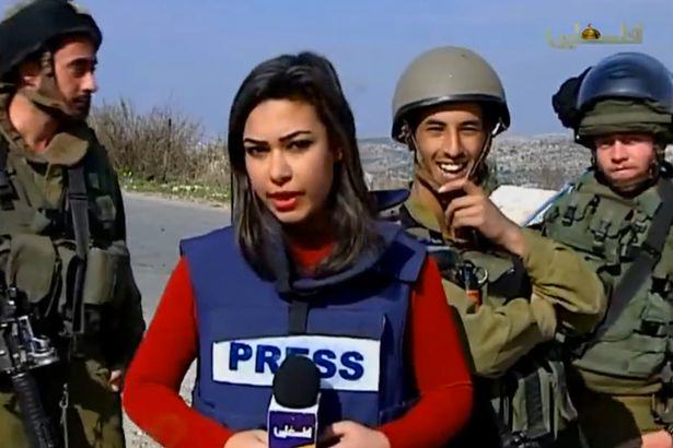 IDF soldiers trolling Palestinian reporter 1 Palestinian Journalist Does Brilliant Job While Being Trolled By Israeli Soldiers