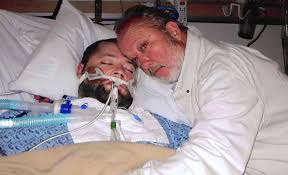 george Father Holds Doctors At Gunpoint   Saves Braindead Sons Life