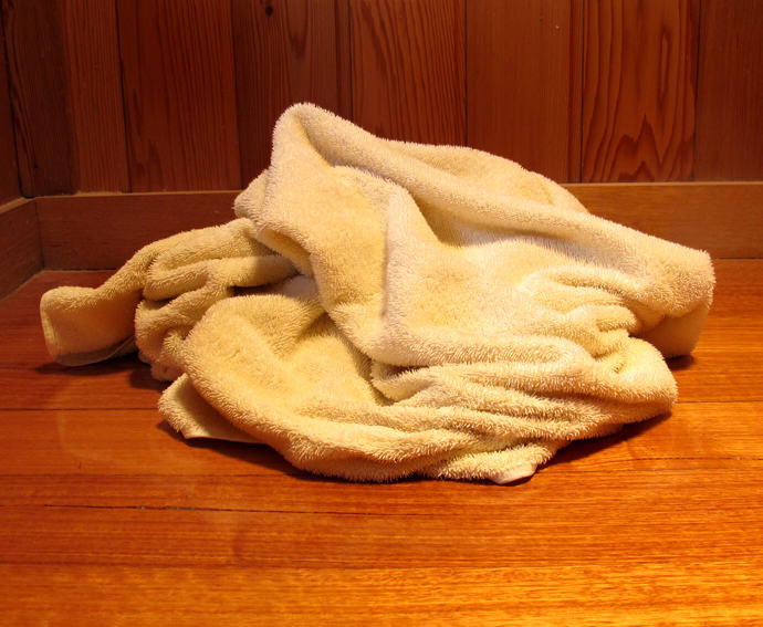 towel on the bathroom floor for web Theres A Really Disgusting Reason Experts Are Recommending Washing Bath Towels Regularly