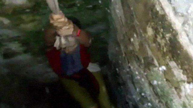 87967795 87967794 Dramatic Footage Shows Woman Rescued After Falling Down Well Taking Selfie