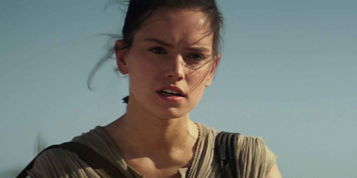 Daisy Ridley as Rey in The Force Awakens Star Wars Director JJ Abrams Teases Answer To Mystery Of Reys Parents