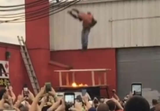wrestle1 Crazy Stunt Sees Wrestler Slam Opponent Off Roof, Through Glass And Fire