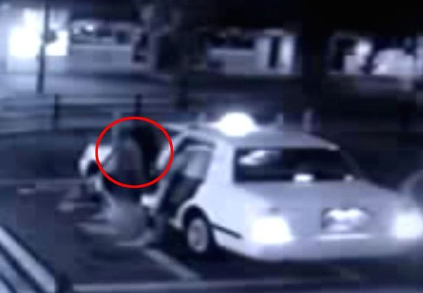 Camera captures ghost woman getting into taxi 615x426 Sinister Footage Shows Ghostly Girl Creeping Into Back Of Taxi