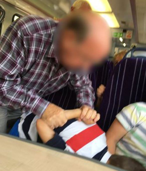 Capture 12 Outrage As Pensioner Puts Child In Armlock For Being Cocky