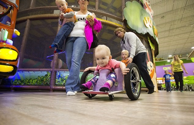 371C7CF000000578 3744173 Nothing can stop her 13 month old Evelyn Moore has been zipping  a 18 1471387290292 Parents Build Awesome Homemade Wheelchair For Paralysed Daughter