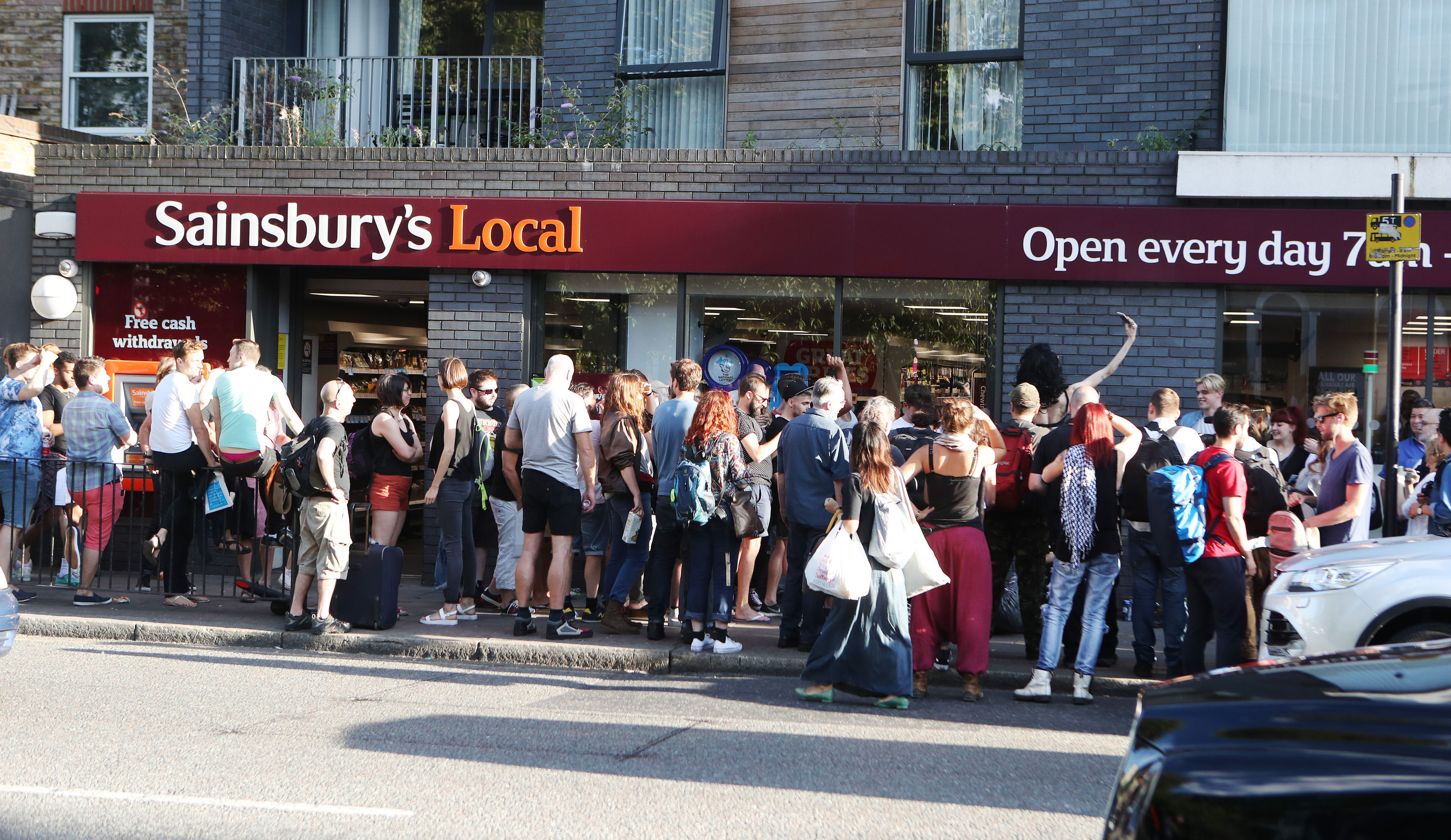 PA 28346434 Hundreds Stage Kiss In Protest After Gay Couple Kicked Out Of Sainsbury's
