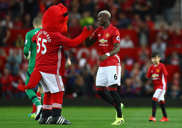 Pogba with mascot Getty Paul Pogba And Eric Baillys Bromance Is Life Goals