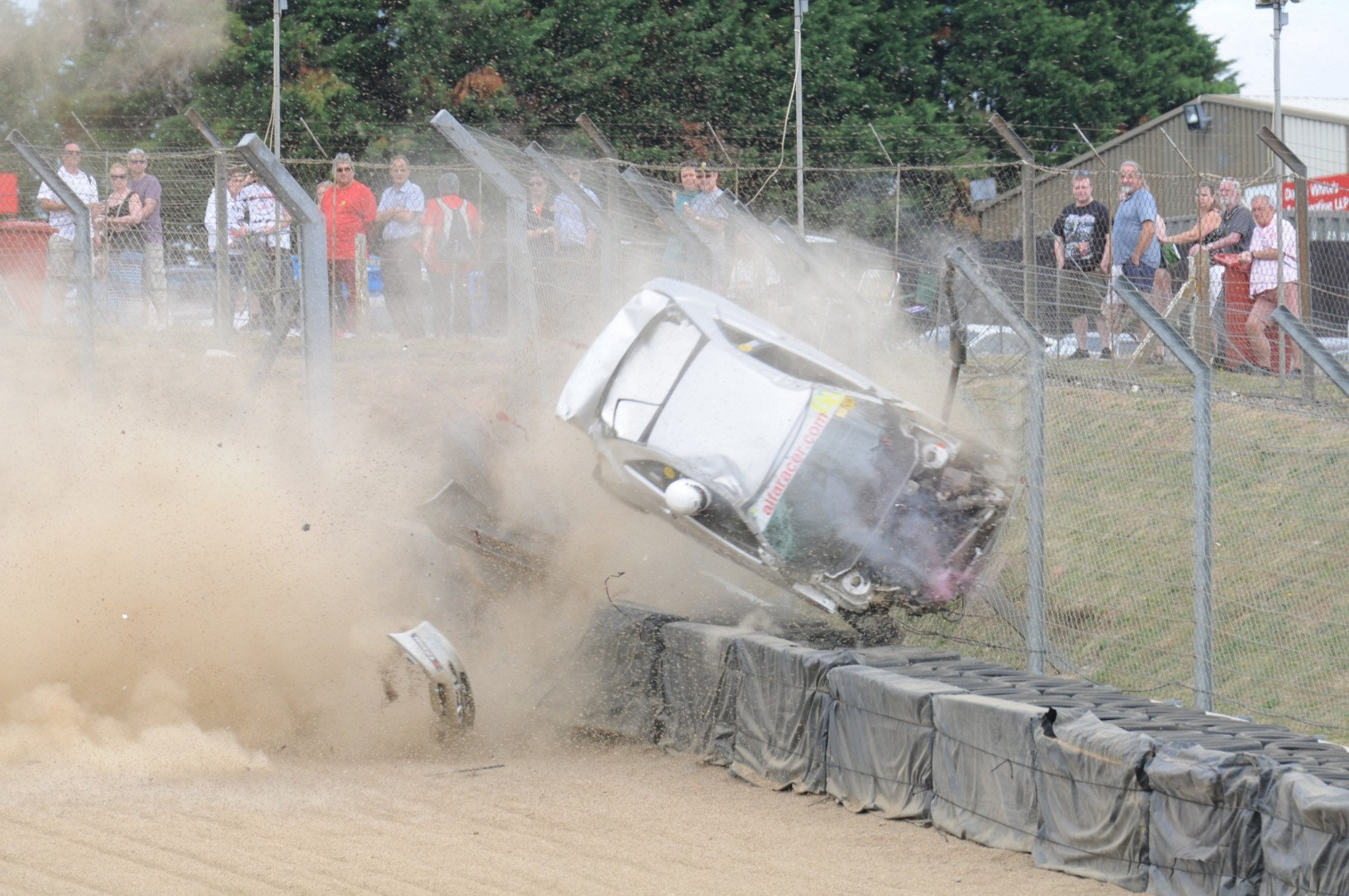 Incredible Moment Racing Driver Survives Crash With Head Out Of Window SWNS CRASH ROLL 08