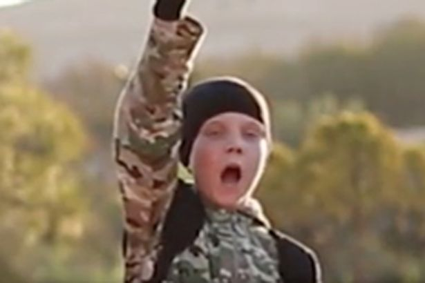 brit isis child Horrific ISIS Video Shows Young British Boy Executing Prisoner