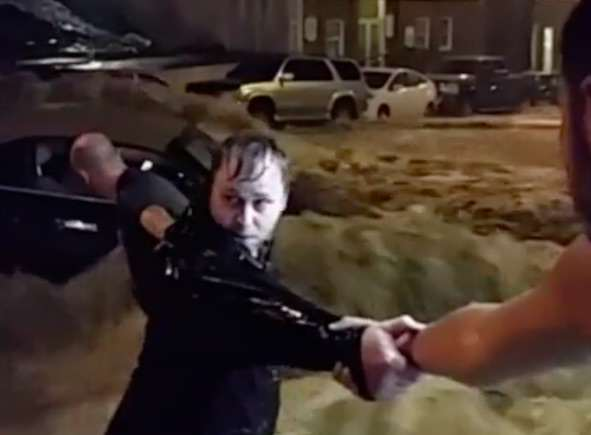 flood3 Watch Incredible Moment Human Chain Saves Woman From Flood