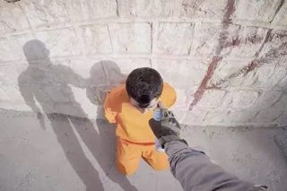 ISIS Spray Paint Target On Man's Head In Sick Execution Video