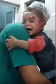 Heartbreaking Video Of Syrian Boy Clinging On For Life After Airstrike Hits His House child