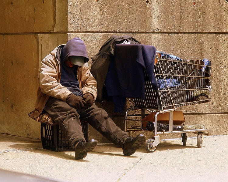 18268UNILAD imageoptim 749px Homeless Man wikimedia Matthew Woitunski These Places Are Doing Free Christmas Dinners For The Lonely And Homeless